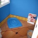 Composting toilet-adds wood shavings